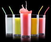 Tasty summer fruit drinks in glass with splash — Стоковое фото