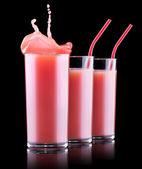 Smoothies de fresa en vaso con splash — Foto de Stock