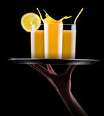 Fresh orange juice in glass with splash — Stock Photo