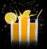 Fresh orange juice in glass with splash — Stock Photo