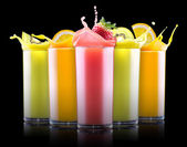 Tasty summer fruits with juice in glass — Stockfoto