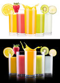 Tasty summer fruit drinks in glass with splash — Photo
