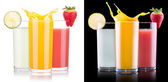 Tasty summer fruit drinks in glass with splash — Foto Stock