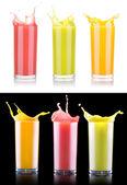 Tasty summer fruit drinks in glass with splash — ストック写真
