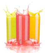 Tasty summer fruit drinks in glass with splash — Stock Photo