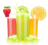 Tasty summer fruit drinks in glass with splash — Foto de Stock
