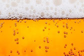 Beer with bubbles close up — Stock Photo