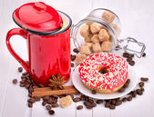 Tasty donut with a cup of coffee — Stock Photo