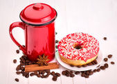Tasty donut with a cup of coffee — Stok fotoğraf