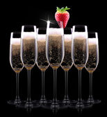 Champagne glass on black background — Stock Photo