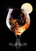 Cognac of cognac op een zwart — Foto de Stock