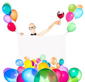 Businessman with banner, balloons and wine — Stock Photo