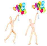 Wooden Dummy with flying balloons isolated — Stock Photo