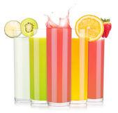 Tasty summer fruit drinks in glass with splash — Stock Photo