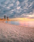 Barceloneta Beach in Barcelona at sunrise — Stock Photo