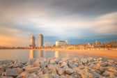 Barceloneta Beach in Barcelona at sunrise — Stock Photo