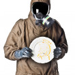 Man in Hazard Suit holding a dirty dish — Stock Photo #12861969