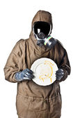 Man in Hazard Suit holding a dirty dish — Stock Photo