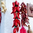 Fresh and dryed Hanged peppers - Stock Photo