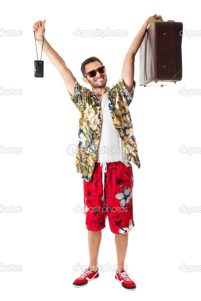 A young, attractive male in a colorful outfit ready to travel as a stereotype tourist — Stock Photo #20319727