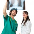 Two doctors and an x ray film — Stock Photo