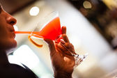 Drinking cocktail — Stock Photo