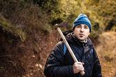 A lumberjack or a psychopath holding a rusty hatchet — Stock Photo