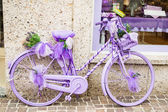 Lilac bycicle — Stock Photo
