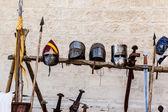 Helmets and swords — Stock Photo