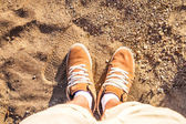 Pair of Boots Shoes man's Foot on sand — Stock Photo