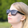 Woman wearing Sunglasses with sky mirroring Blond Hair Head Look up Outdoor Summer Day — Stock Photo