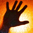 Hands Silhouette on Fire Orange Color Background stained glass with geometric pattern Horror Cinematic and concept of Phobia and Depression Emotion — Stock Photo #29556483