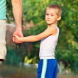 Family Father Man and Son Boy Child holding hand in hand Outdoor Happiness emotion with summer nature on background — Stock Photo