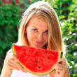 Young Woman with big slice Watermelon Berry fresh in hands Beautiful Smiling Face and Blonde Hair with green nature on background Organic Food concept — Stock Photo