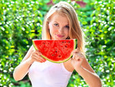 Young Woman with big slice Watermelon Berry fresh in hands Beautiful Smiling Face and Blonde Hair with green nature on background Organic Food concept — Foto Stock