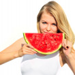Young Woman eating big slice Watermelon Berry fresh in hands Beautiful Smiling Face and Blonde Hair Organic Food concept isolated on white background — Stock Photo #30684429