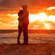 Couple Man and Woman Hugging in Love staying on Beach seaside with Sunset scenery People Romantic relationship and Friendship concept — Stock Photo #32662163