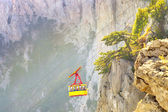Yellow Funicular Cable with cabin high with Rocky Mountains on background (Crimea, Ai-Petri Mountain) Summer day — Stockfoto