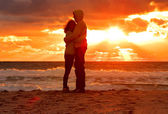Couple Man and Woman Hugging in Love staying on Beach seaside with Sunset scenery People Romantic relationship and Friendship concept — Stock Photo