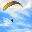 Paragliding extreme Sport with blue Sky and clouds on background Healthy Lifestyle and Freedom concept — Stock Photo #33499781