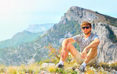 Young Man Traveler relaxing with Mountains on background Hiking and Healthy Lifestyle concept — Stok fotoğraf
