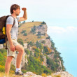 Stock Photo: MTraveler with backpack looking forward outdoor with hands up mountains on background Freedom and Healthy Lifestyle Hiking concept