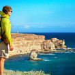 Stock Photo: MTraveler with backpack relaxing outdoor with Seand Rocks