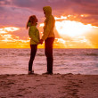 Couple Man and Woman in Love standing on Beach seaside holding h — Foto de Stock