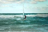 Sea Windsurfing Sport sailing water active leisure Windsurfer training on waves summer day Lifestyle concept — ストック写真