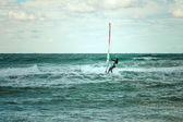 Sea Windsurfing Sport sailing water active leisure Windsurfer training on waves summer day Lifestyle concept — Stock Photo
