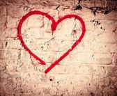 Red Love Heart hand drawn on brick wall grunge textured background — Stockfoto