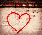 Red Love Heart hand drawn on brick wall grunge textured background — Foto Stock
