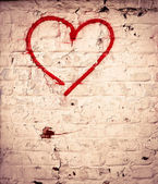 Red Love Heart hand drawn on brick wall grunge textured background — Stock Photo