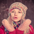 Young Woman Beautiful Winter time wearing knitted hat and gloves and blowing air kiss Lifestyle Expression emotions concept and Christmas holiday trendy colors — Foto de Stock